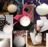 きれいなギフト用包装紙の毛皮POM袋の魅力のキツネの毛皮Poms