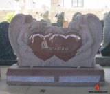 De rode Engel die van de Grafsteen van het Graniet HerdenkingsGrafsteen met Dubbel Hart snijden