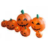Halloweenのしかめつらが付いているおかしいオレンジ膨脹可能なカボチャ