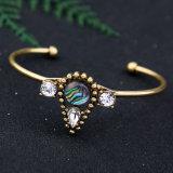 Nuovo braccialetto aperto intarsiato semplice poco costoso della retro dell'acqua lega di cristallo di goccia per le donne