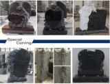 Lápide de granito com esculturas de ângulo
