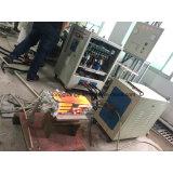 La forgia degli strumenti della direzione dell'ascia indurisce la macchina termica del riscaldatore di induzione