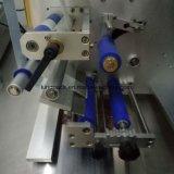 두 배 옆 둥근 병 레테르를 붙이는 기계