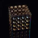 Debossedのドット・パターンが付いている虹色の蝋燭の瓶