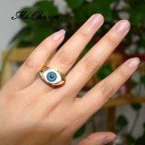 El estilo punky suena los anillos de bodas azules del ojo malvado de la resina del color