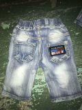 卸し売り子供の不足分のジーンズ