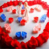 Vela rosada en vela caliente del té de la dimensión de una variable del corazón