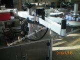 유리병 레테르를 붙이는 기계
