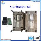 O trabalho feito com ferramentas plástico da modelagem por injeção presta serviços de manutenção ao jogo solar do regulador