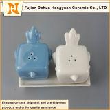 Fabbrica di ceramica Cina diretta degli agitatori di sale e di pepe dell'uccello di nuova vendita calda di disegno