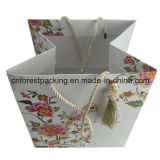 Bolso de compras de papel de lujo de encargo de China con la cinta