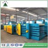 Ramasseuse-presse de la machine pour le carton, toutes sortes de déchets de papier, paille, de plastique PET, la mise en balles hydraulique de l'OCC/horizontal//automatique/presse à balles de recyclage propre usine/ce/ISO/IAF/CNA