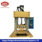 Fornitore la pressa di stampaggio calda Xdy-1001-1 del coperchio del più piccolo modello della custodia per armi di plastica pneumatica a più strati del telefono mobile