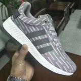 Modèle d'usine de chaussure de la Chine le plus défunt folâtre les chaussures de course du football en gros de sports de chaussures pour les hommes