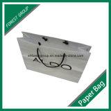 El papel del arte de la bolsa de papel impreso con logotipo de barniz UV