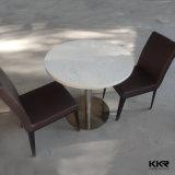 椅子が付いている固体表面のホテルのレストランの家具の石表