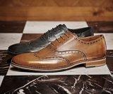 中国の本革の人のなまけ者の履物の服靴