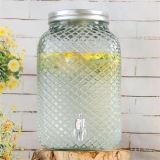 金属のふたの蛇口が付いているガラス飲料の記憶の瓶が付いている大型のガラス瓶