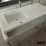Dessus en pierre artificiel de vanité de salle de bains moderne d'hôtel
