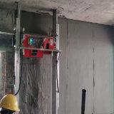 新技術の機械を塗る自動コンクリートの建物の壁