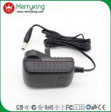 La marca de fábrica de Merryking Pared-Monta el adaptador BRITÁNICO de la potencia del enchufe AC/DC del adaptador de 12V 1A