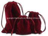Pequeña bolsa de encargo de la joyería del lazo del terciopelo