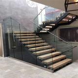 現代的な純木はガラス柵との浮遊ステアケースデザインを使用した