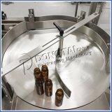 Pequena garrafa de enchimento líquido rotativo e tampar a linha da máquina