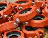 Accessorio per tubi ed accoppiamento scanalati ferro duttile