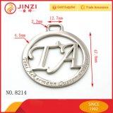 Étiquette faite sur commande de coup de logo de logo en métal d'étiquette de sac à main d'étiquette de luxe creuse de bijou