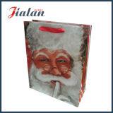Bolsa de papel impresa insignia de encargo del diseño del festival del día de la Feliz Navidad
