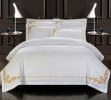 Los conjuntos de ropa de cama blanca bordada