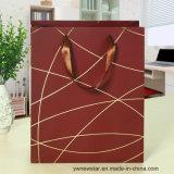 Bolso del regalo del papel del color del café con la cuerda de rosca del oro