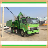 トラックHOWOクレーン4X2トラックのトラクターによって取付けられるクレーンはクランプバケツを備えている
