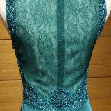 Pfau-Blau, das Spitze-Abend-Kleid bördelt