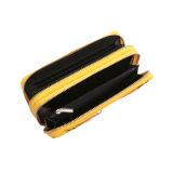 Яркая желтая застежка-молния украсила бумажник муфты застежка-молнии двойника вечера (MBNO043113)