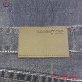 Grabado el logotipo y Material de PU de auténtico cuero personalizada Etiqueta para las prendas de vestir