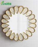 金の装飾的な金属によって組み立てられる壁ミラー