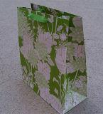品質はリボンのハンドルが付いている印刷されたギフトの紙袋をカスタム設計する