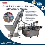 Máquina que capsula rotatoria de los casquillos plásticos dobles de las pistas para el champú (HC-50-2)
