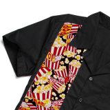 Chemises de polo de roulement estampées par maïs éclaté en gros d'usager
