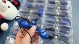 Lo strumento chiaro protettivo Blackdoll di bellezza di vetro E del laser sceglie gli occhiali di protezione di ombreggiatura di rimozione dei capelli del sopracciglio (uso dell'ospite)