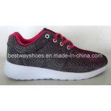 Le tissu folâtre des chaussures pour des dames