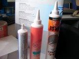 歯磨きのチューブ、装飾的な管、手のクリーム色の管