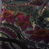 Floreale bruciare il tessuto del velluto. Tessuto del velluto della stampa floreale