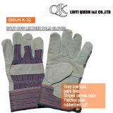 K-31灰色分割された牛革はやしはさみ金によって貼られた袖口の皮手袋を修繕した