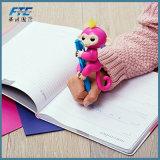 El dedo elegante electrónico del tacto embroma el mono interactivo de los pececillos del unicornio del juguete