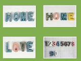 L'alfabeto d'ottone decorativo dell'anello chiave della resina della parete segna a casa