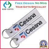 Kundenspezifisches preiswertes Stickerei-Gewebe Keychain, entfernen vor Flug Keychain