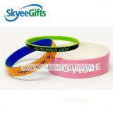 Wristbands poco costosi su ordinazione del silicone con l'inchiostro di colore riempito